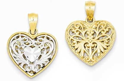 14k gold two tone reversible filigree heart pendant weighs 1g measures 916w x 34h