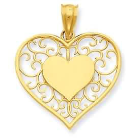 14k gold heart in heart polished and filigree pendant weighs 13g measures 78w x 1h