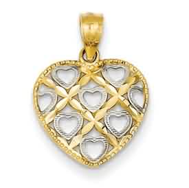 14k gold and Rhodium DC heart pendant weighs 61g measures 916w x 34h