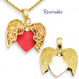 14k gold heart pendant with red enamel reverses to white heart inside another opening he